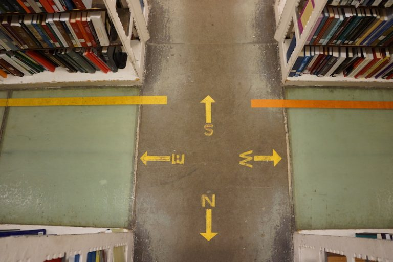 Picture of the floor in Hatcher Library stacks, with ordinal floor guides