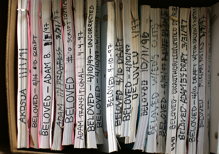 "A box of bound documents spines facing out, labeled ""Beloved"" with dates, most of them in 1977"