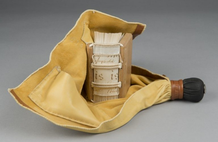 Model of a girdle book, small portable books worn by medieval European monks, clergymen and aristocratic nobles