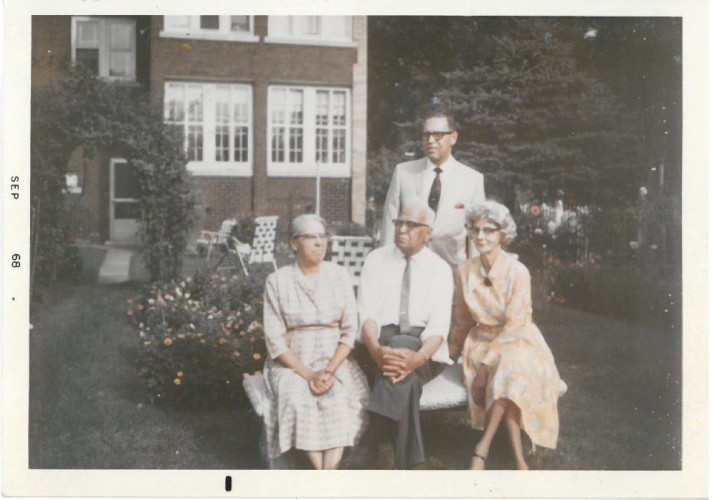 A family photo, taken outdoors, of W. A. and Mamie Thompson with their adult son and his wife